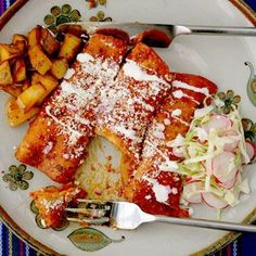 Red Chile Enchiladas  Recipe: http://www.saveur.com/article/Recipes/Red-Chile-Enchiladas