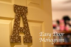 Easy door monogram using @americancrafts @dearlizzy paper from @Joannstores and a wood letter. SO fun for a girl's room