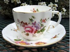 Beautiful cup and saucer. Protect these treasures while also keeping them on display with cup & saucer stands and hangers.