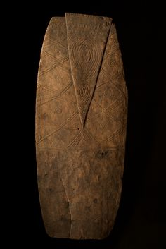 Middle Ramu River, PNG. War shield with traces of pigment.