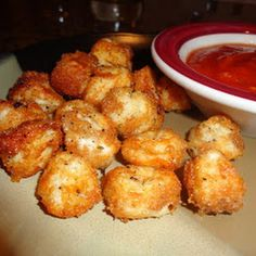 Baked Cheese Balls! String cheese chopped into bite size pieces, dipped in milk and bread crumbs, baked at 400 for 8-10 minutes- serve with marinara sauce!