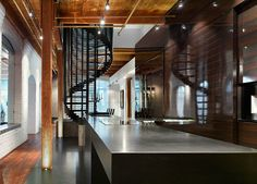 kitchen counter / brick wall / wood fisnish / spiral staircase ...