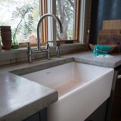 concrete counters, farmhouse sink, bridge faucet - Ann Lowe Design