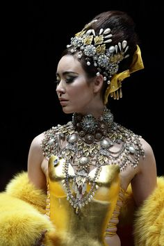 A model showcases designs by Guo Pei on the catwalk on day 8 of Fashion Week 2013 at the Sands Expo & Convention Centre.