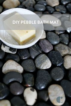 This DIY pebble bath mat brings instant spa-like feeling into your home! In this tutorial, we use river rocks and contact cement to make a pebble bath rug.