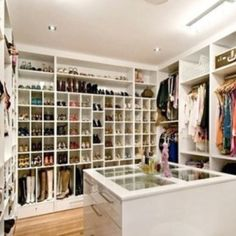 Accessory closet. Custom space for boots shoes and jewelry in the center island.