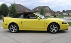 Even though I know infinitely more about cars now, I will ALWAYS want/love the 2003-2004 yellow Ford Mustang convertible <3