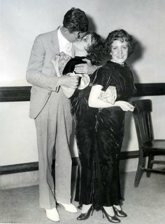Daisy and Violet Hilton. Violet kissing her fiance, Maurice Lambert.