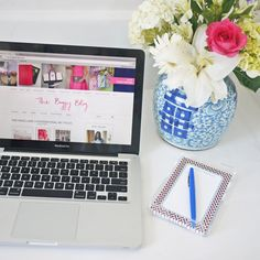 Work station with nice personalized stationery & fresh flowers!