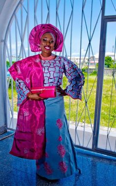 Yoruba bride in pink and blue aso oke...always a winning combo. bright and beautiful. More on www.weddingfeferity.com