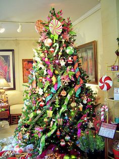 Theme trees are so much fun! What about a CandyLand Christmas Tree? #Christmas #ChristmasDecor