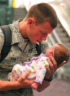 soldier and his baby