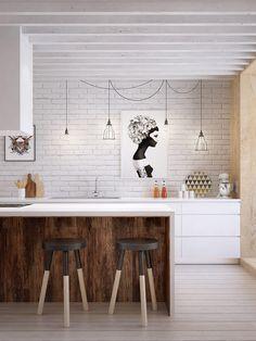 white cabinets + white brick walls + art + pendant bulbs + reclaimed wood island detail