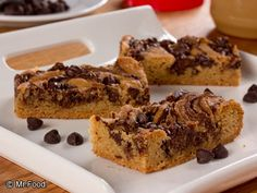 Peanut Butter Swirl Bars - Peanut butter and chocolate never looked so good! Bring these dessert bars along to potlucks and parties and watch 'em disappear before your eyes.