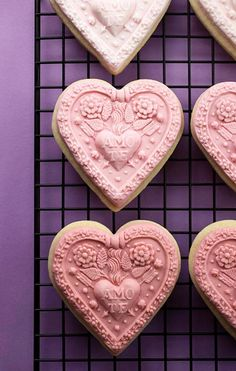 "Gorgeous Valentine cookies.  Pink fondant molded in candy molds and ""glued"" to sugar cookies with frosting.  So pretty!"