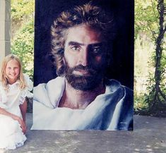 This painting was created by the 8 year old girl shown in the picture. I feel like I see Jesus when I look at this. Amazing. The girl's name is Akiane and the painting is called Prince of Peace.