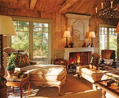 PA retreat decorated by Penny Drue Baird via AD Love the chaise, the exposed wood, the beams, fireplace, rod iron, huge windows, everything! So cozy!