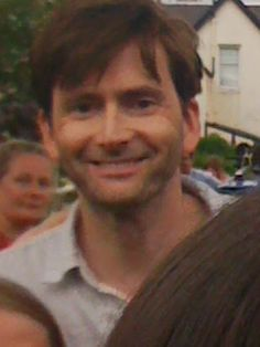 Fan photo of David Tennant signing autographs and...