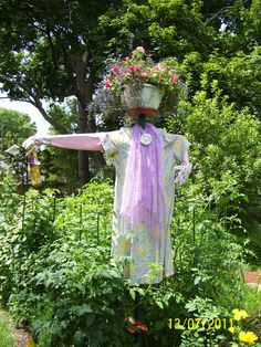 unique scarecrow. if I put this in my garden will I be concidered a crazy old lady?