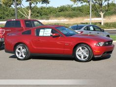Ford Mustang GT Coupe # Loaded with features like 6-Speed transmission, 5.0L V-8 cyl engine, premium unleaded fuel type etc available in Red Candy color at Ron DuPratt Ford.