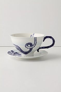 From the Deep Cup & Saucer: Stoneware, dishwasher and microwave safe. I love the tentacle handle! $14. Blue and White
