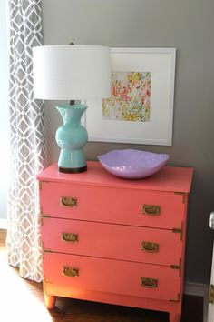 Basic dresser transformed with new hardware and beautiful coral paint (Dishy Coral from Sherwin Williams) in a high gloss.  Amazing transformation From Honey Haven Blog