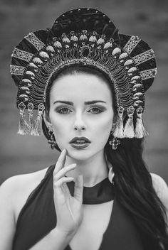 Russian-style fashion photograph. A model in a kokoshnik.