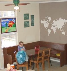 This is my eat-in kitchen.  I love my wrap around bench - perfect for fitting the whole family!