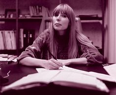 Joni Mitchell, signing her first record contract, 1968. Photo by Ed Thrasher.