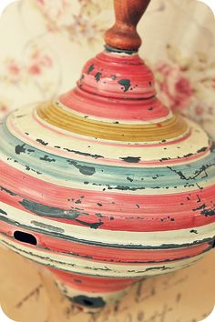 Vintage spinning top. Love the colors.