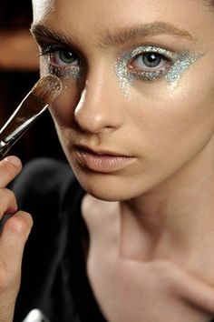 GIAMBATTISTA VALLI - Dewy complexions and nude lips were offset by blue, green and silver glitter around the eyes.