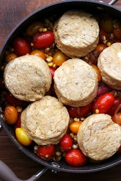 A savory tomato cobbler topped with cheddar buttermilk biscuits and filled with chipotle-roasted cherry tomatoes, fresh sweet corn, and delectable caramelized onions – it is sure to be the hit of whatever party you bring it to!