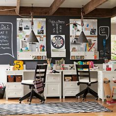 shared workspace.  chalkboard wall, pulley pendants, rug, and chairs.