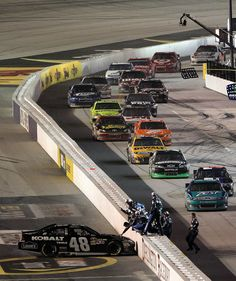 NASCAR Drivers on pit road with Jimmie Johnson win , and Kasey Kahne on pit road