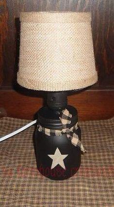 Omg so adorbs!! https://www.etsy.com/listing/183472414/primitive-mason-jar-lamp-country-home