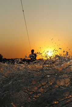 Wakeboarding at sunset.