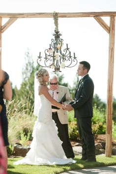 Alter / Arch with Chandelier | Cute for a #shabbychic #outdoor wedding ceremony | On SMP: http://www.StyleMePretty.com/northwest-weddings/2013/12/10/rustic-oregon-wedding-at-aspen-lakes/ Kimberly Kay Photography