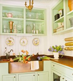 green cabinets, white walls