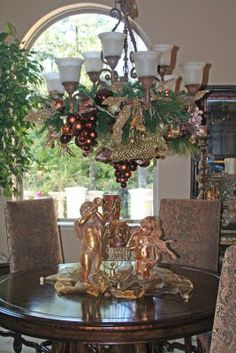 Chandelier Arrangement Gold, Brown, and Copper with a splash of Leopard.