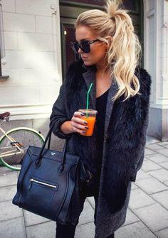super chic // black faux fur vest over grey sweater.