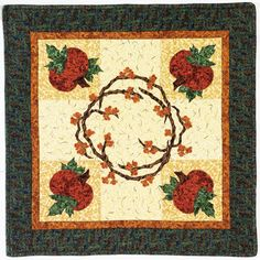 This quilted table topper pattern with applique flowers and pumpkins make for an elegant fall sewing project. From the book:http://landauerpub.com/Granola-Girl-Designs-Table-Toppers-Celebrating-the-Great-Outdoors.html