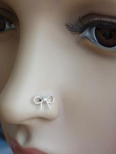 Cute bow nose ring.