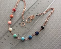 Love the rainbow effect and clasp.