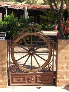 wagon wheels, western iron fence, wrought iron gates, garden gate, barns