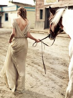 Equestrian wedding love + one amazing dress over at http://www.spelldesigns.com/