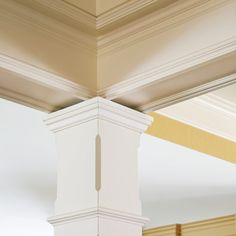 A traditional post with chamfered corners reinforces the detail in the coffered ceiling. | Photo: Laura Moss