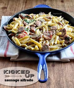 Kicked Up Sausage Alfredo with spinach and sundried tomatoes. Recipe at TidyMom.net