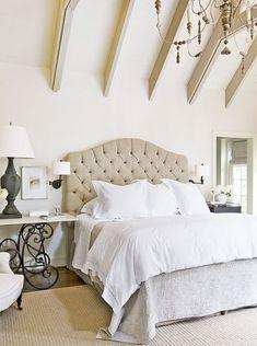 headboard. bedding. tall ceilings.
