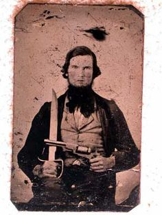 Double-armed Texas Confederate with Bowie Knife and Colt Dragoon Revolver. {Michael Simens Civil War imagery & items}.