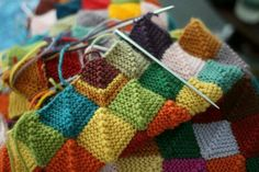 Love this - great for using up all those bits of yarn... Knitted blanket